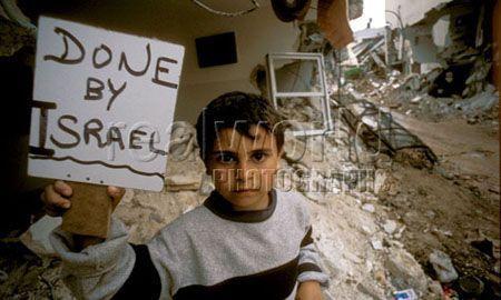 1102_boy_sign_palestine_israel_war_